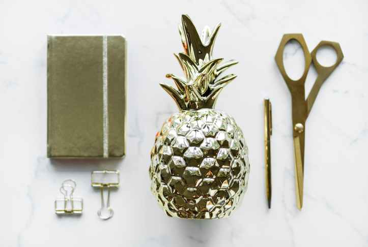 gold colored pineapple scissors clamp decors
